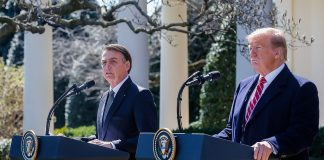https://commons.wikimedia.org/wiki/File:Bolsonaro_with_US_President_Donald_Trump_in_White_House,_Washington,_19_March_2019.jpg